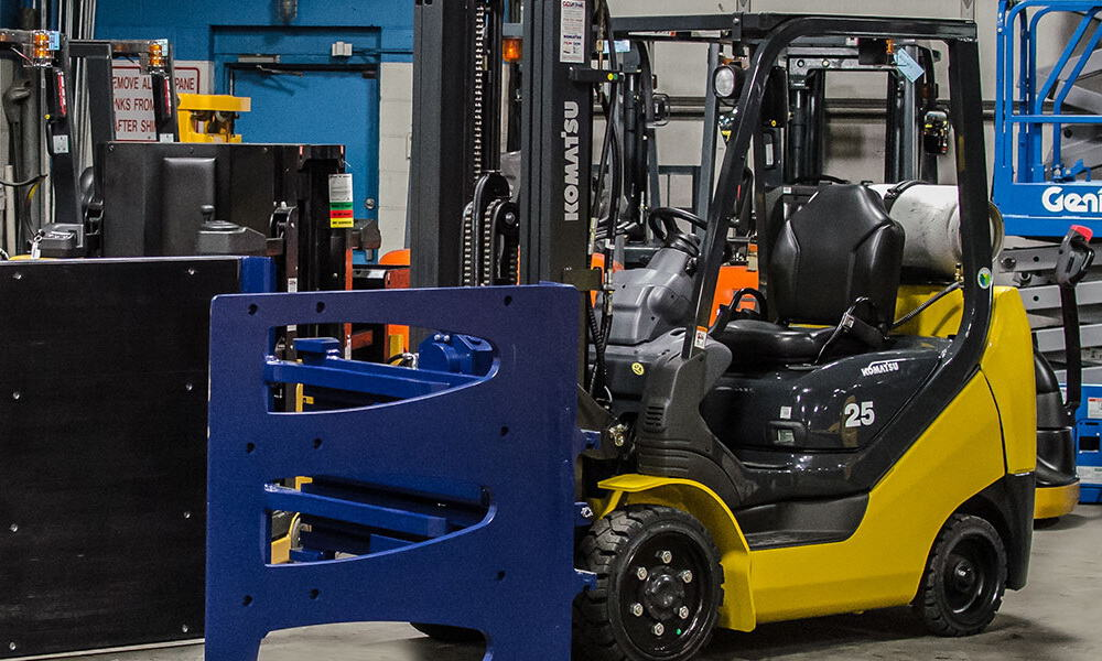 Multi-pallet handlers are attachments that allow a forklift to lift two pallets simultaneously using multiple fork tines. Operators must be aware that multi-pallet handlers do not increase the load capacity of any forklift.